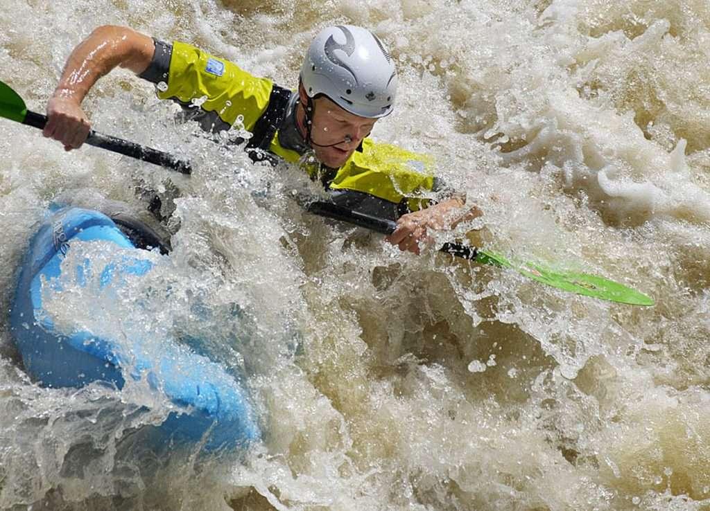 Whitewater kayaking on Shepperton Weir, UK